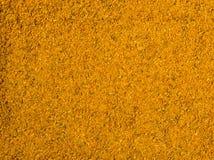 Priorità bassa di struttura Preparato giallo della spezia per Kari Fotografia Stock