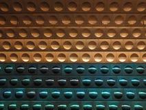 Priorità bassa dorata e verde del metallo con i cerchi Immagine Stock