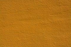 Priorità bassa gialla di struttura della parete Fotografie Stock