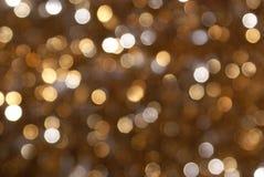Priorità bassa Glittery della sfuocatura dell'oro Fotografia Stock Libera da Diritti