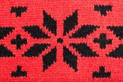 Priorità bassa lavorata a maglia rossa. Fotografia Stock