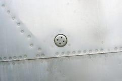 Priorità bassa metallica astratta Struttura rivettata del metallo Fotografia Stock