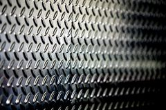 Priorità bassa metallica perforata strutturata Fotografie Stock
