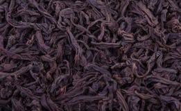 Priorità bassa nera delle foglie di tè Immagine Stock