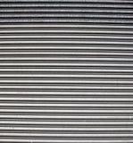 Priorità bassa ondulata del metallo Fotografie Stock Libere da Diritti