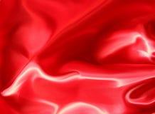 Priorità bassa rossa dell'estratto del raso Fotografie Stock