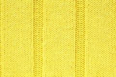 Priorità bassa strutturata del tessuto lavorata a maglia colore giallo Fotografia Stock Libera da Diritti