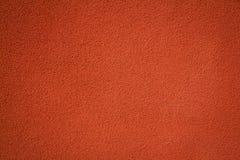 Priorità bassa strutturata della parete dello stucco rosso Fotografia Stock Libera da Diritti