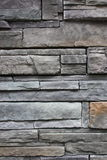 Priorità bassa strutturata della parete di pietra dell'ardesia Fotografia Stock