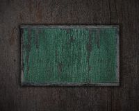 Priorità bassa strutturata di legno e targhetta verde. Fotografia Stock Libera da Diritti