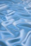Priorità bassa blu del raso Fotografie Stock