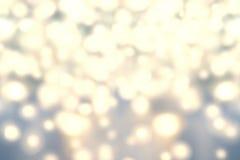 Priorità bassa degli indicatori luminosi di natale Estratto dorato B Defocused di festa Fotografia Stock