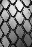 Priorità bassa del pneumatico nero di inverno Fotografie Stock