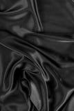 Priorità bassa di seta nera del raso Fotografia Stock Libera da Diritti