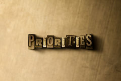 PRIORITIES - close-up of grungy vintage typeset word on metal backdrop. Royalty free stock illustration.  Can be used for online banner ads and direct mail Stock Image