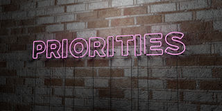 PRIORITIES - Glowing Neon Sign on stonework wall - 3D rendered royalty free stock illustration Stock Photos