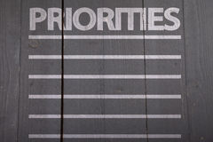 Priorities list. On black wooden background Royalty Free Stock Images