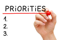 Priorities List. Hand writing Priorities list with marker isolated on white Stock Image