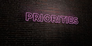 PRIORITIES -Realistic Neon Sign on Brick Wall background - 3D rendered royalty free stock image. Can be used for online banner ads and direct mailers Royalty Free Stock Photo