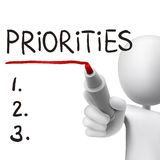 Priorities word written by 3d man. Over white Stock Photos