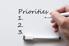 Priorities written on whiteboard Stock Image