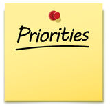 Priorities, yellow paper note. Pinned to a notice board Royalty Free Stock Photography