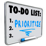 Prioritize Word To Do List Manage Workload Many Tasks. Prioritize word on a to do list written on a dry erase board to help you manage your jobs or tasks in your Royalty Free Stock Image