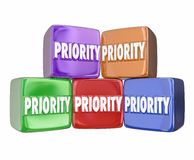Priority Blocks Cubes Boxes Most Important Urgent Jobs Tasks Con. Priority word on 3d cubes or blocks to illustrate ranking the most important jobs, tasks Royalty Free Stock Photography