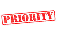 PRIORITY. Red rubber stamp over a white background Royalty Free Stock Image