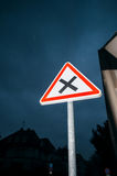 Priority on the right Dangerous uncontrolled intersection ahead. Priority on the right under rain - Dangerous uncontrolled intersection ahead street sign agains royalty free stock images