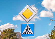 Priority road and Pedestrian crossing traffic signs stock photos