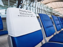 Priority seats row indoor Airport Public Facility Stock Image