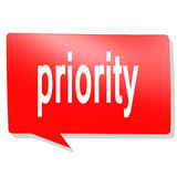 Priority word on red speech bubble Royalty Free Stock Image