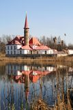 Priory Palace on the shore of a pond in a Park in Gatchina. Stock Photos
