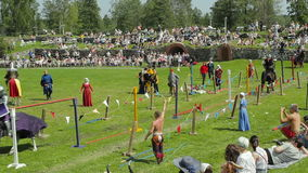PRIOZERSK, RUSSIA- JULY 05, 2015: Equestrian joust during the historic medieval festival. PRIOZERSK, RUSSIA- JULY 05, 2015:Jousting tournament on horseback stock video footage