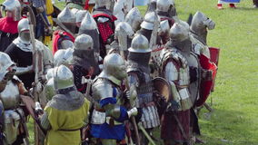 PRIOZERSK, RUSSIA- JULY 05, 2015: Knights prepare for battle during the historic medieval festival. Russian fortress in the town of Priozersk, Korela, Russia stock video