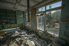 20/10/2018 Pripiyat, Ukraine, many scattered books in the classes of the abandoned school. In Pripyat royalty free stock image