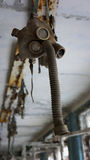 Pripyat Gas Mask. A gas mask hangs in an abandoned military school in Pripyat, inside the Chernobyl 10 km isolation zone, Ukraine Royalty Free Stock Photography