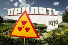 Pripyat Town Sign and Radiation Warning Royalty Free Stock Images