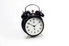 Prisa de la acometida del reloj de alarma Imagen de archivo libre de regalías