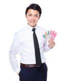 Prise d'homme d'affaires avec le billet de banque chinois Images stock