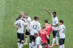 Prise d'un reniflard pendant le jeu de Manchester United Image libre de droits