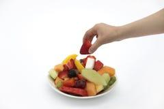 Prise d'une fraise Photographie stock libre de droits