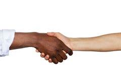Prise de contact interraciale Photo stock