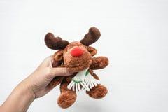 prise de femme un jouet de renne Images libres de droits