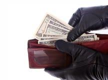 Prise de l'argent de la pochette Image libre de droits