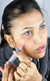 Prise de l'injection de botox photos libres de droits
