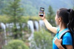 Prise de la photo avec le téléphone portable Photos stock