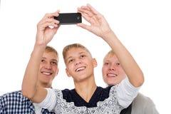 Prise de trois jeunes hommes sur l'individu Photographie stock libre de droits