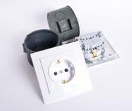 Prise deux électrique sur le fond clair Photographie stock libre de droits